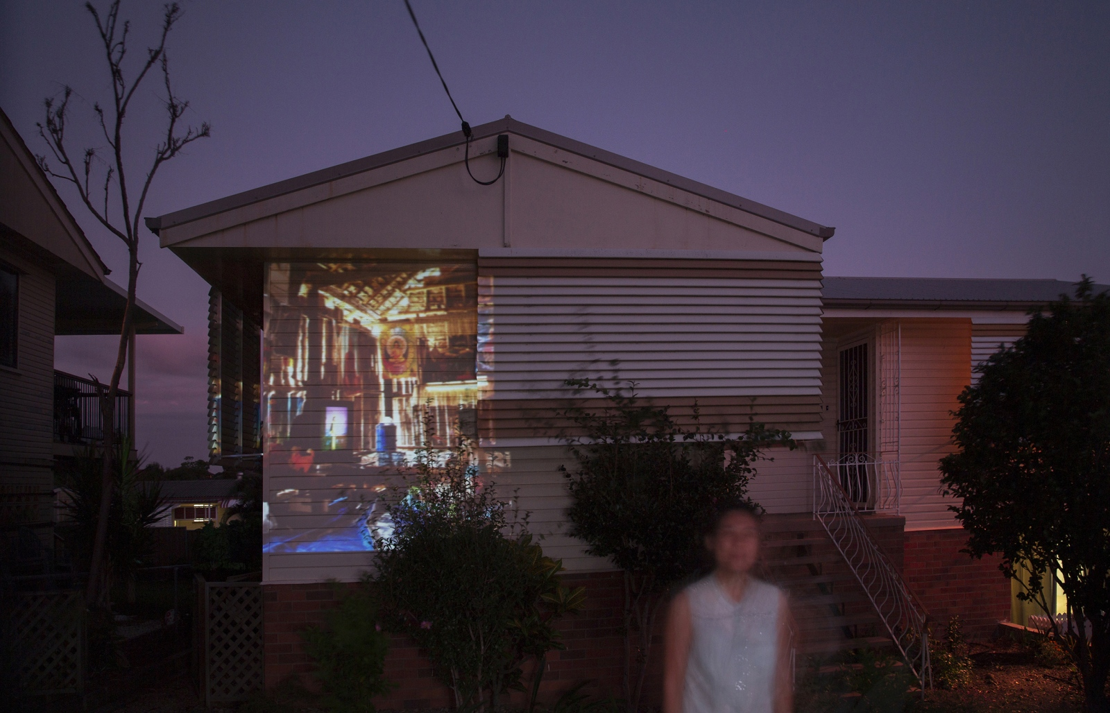 A projection of the inside of a house in Mae La refugee camp. This 'temporary' camp was established in 1984 and currently still holds over 50,000 refugees. This image has been projected onto the home of a well established Karen family now residing in Brisbane. QUEENSLAND, AUSTRALIA, 2016.