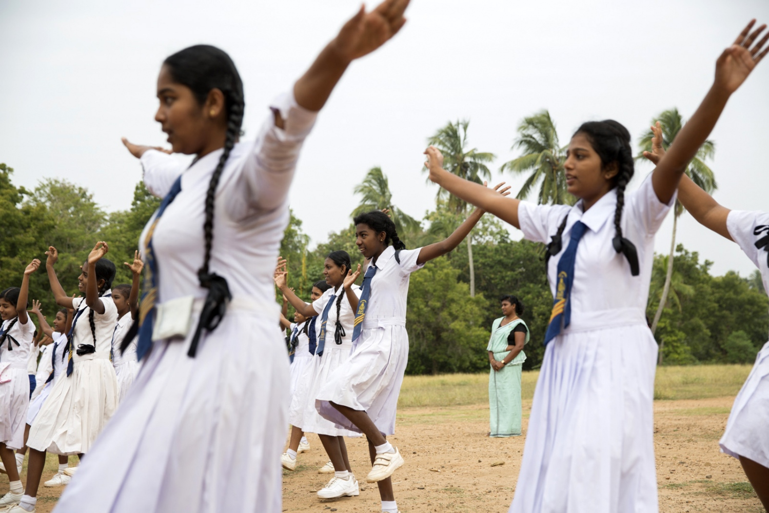 Afro-Sri Lankan Olivia Alexander, 14, takes part in daily morning exercises at Sirambadiya school.