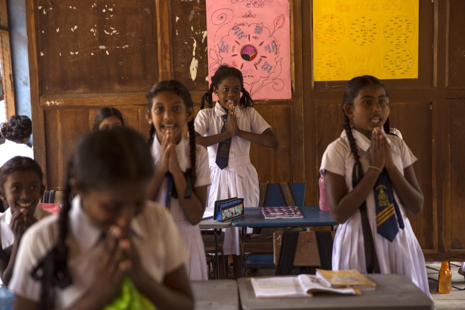 Afro-Sri Lankan Warnakulasuriya Pravin Madushan, 10, attends class at Sirambadiya School.