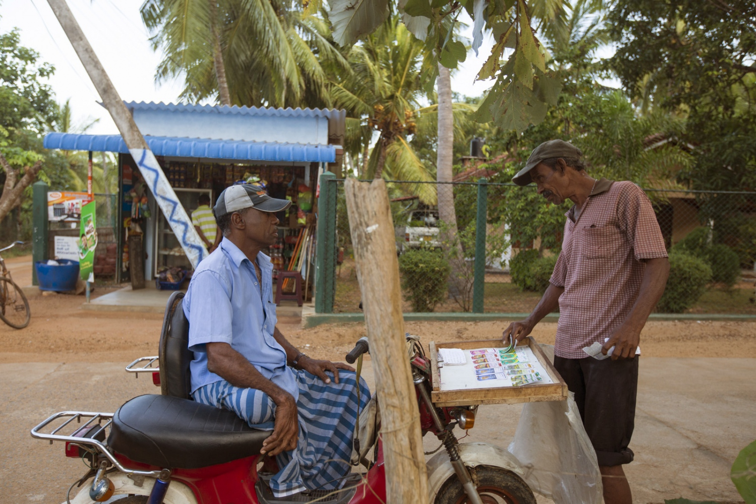 Peter Luis has been physically disabled from Polio since he was 3 years old. He makes his money selling lottery tickets on a specially made three-wheeler motorbike.