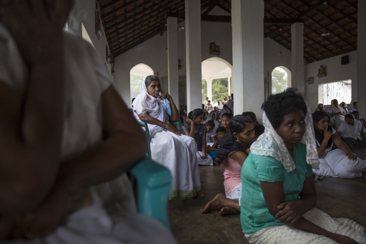 A mixture of Afro-Sri Lankans and Sinhalese attend Sunday morning Mass in Sirambadiya.