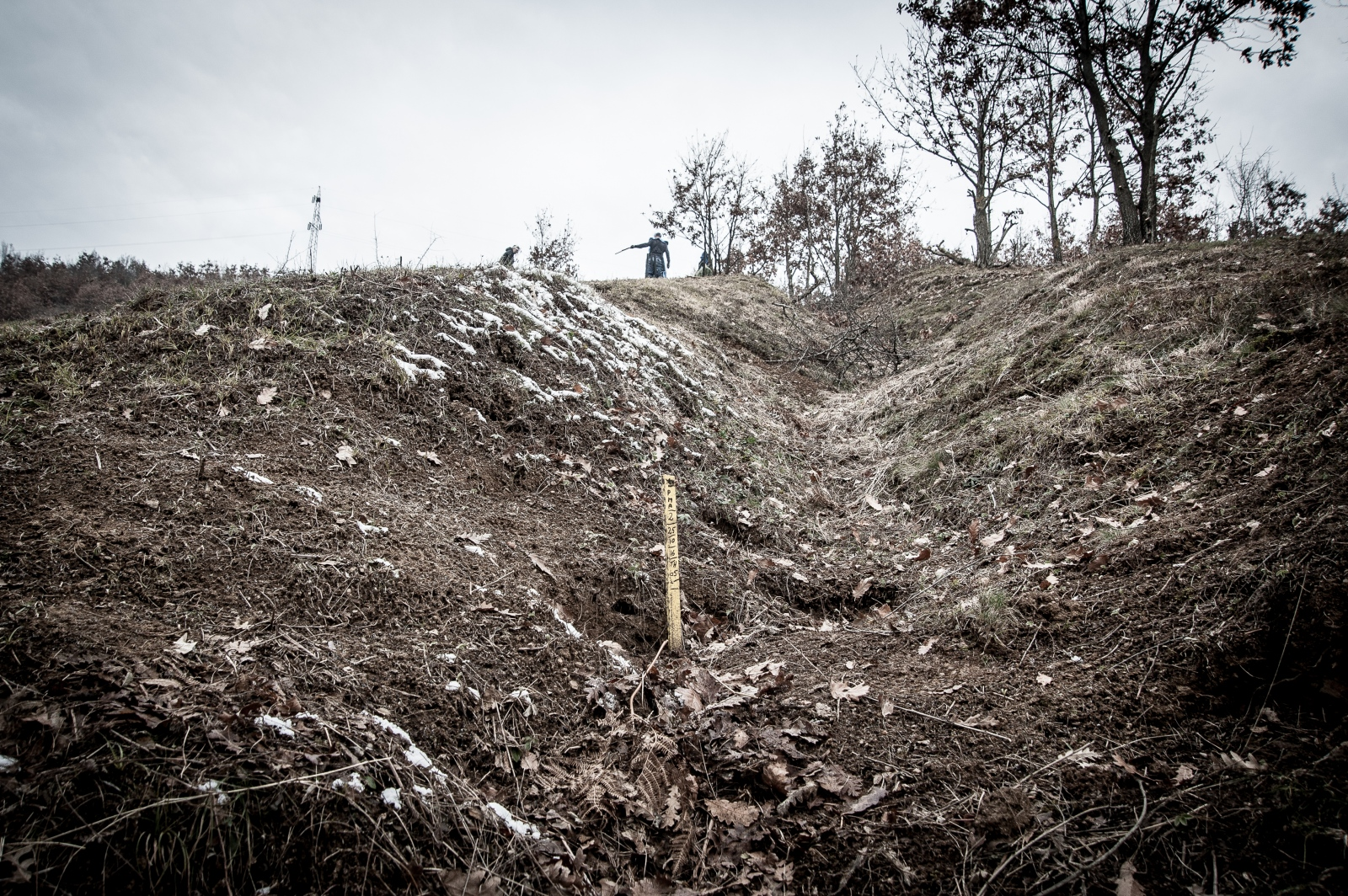 A yellow stake indicates where a landmine was found and deactivated among the woods in northwestern Kosovo. December 2016.