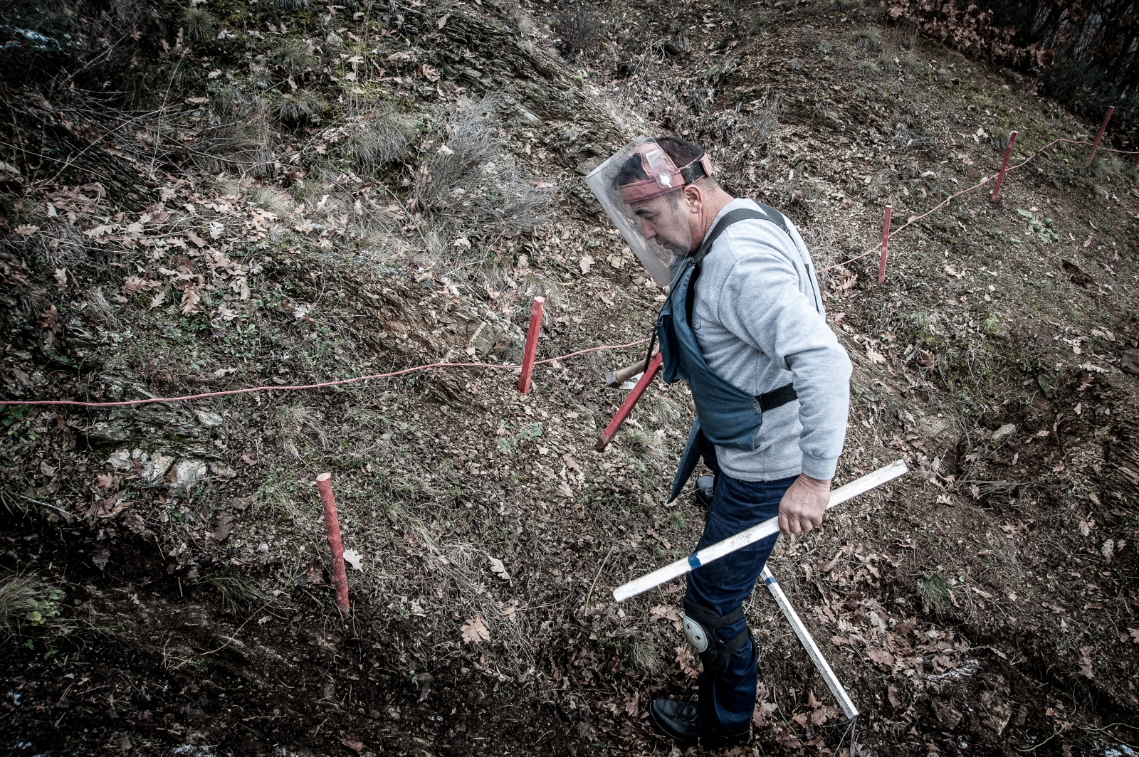 A worker stakes a field in northwestern Kosovo. December 2016.