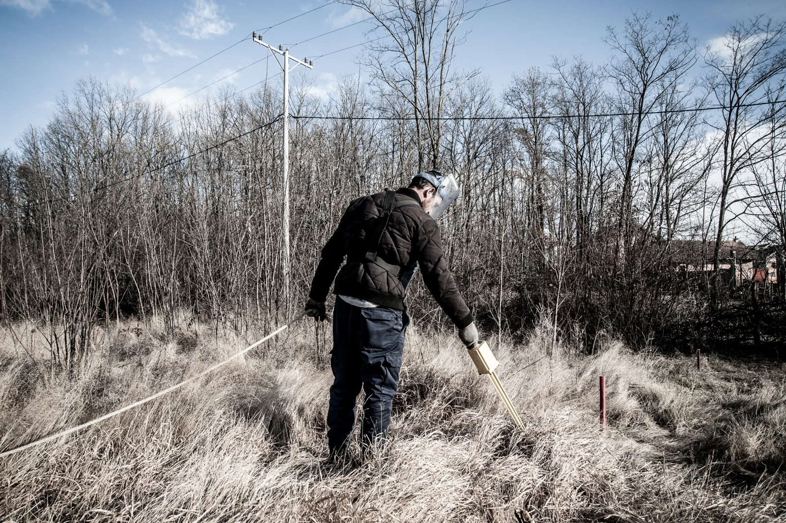 A de-miner at work in a minefield, with an area of 191.000 m², located next to the village of Kryshec. The mine clearance operation team in Kryshec is made of 16 people. December 2016.
