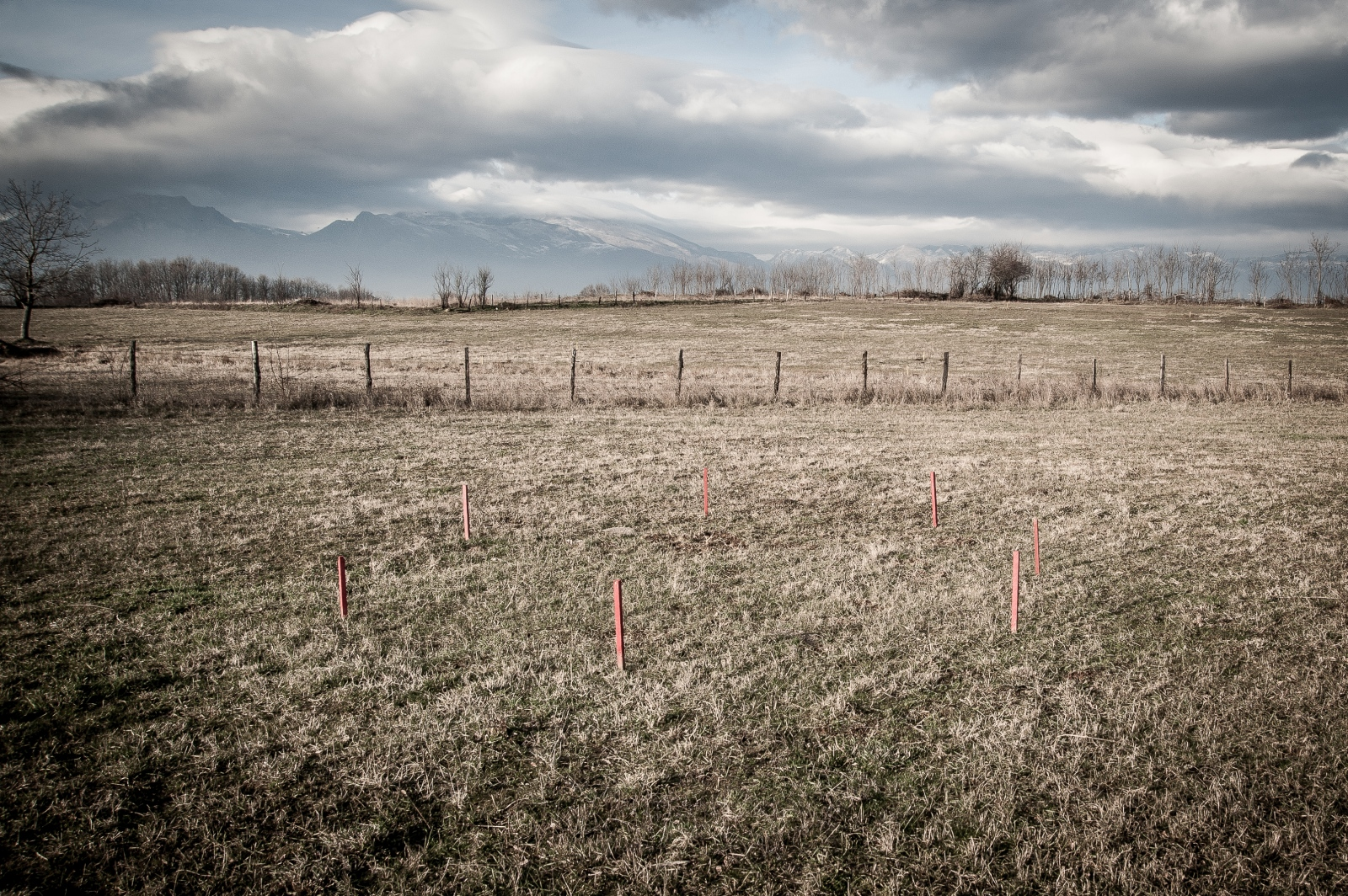 The red stakes mark a contaminated area in central Kosovo. December 2016.