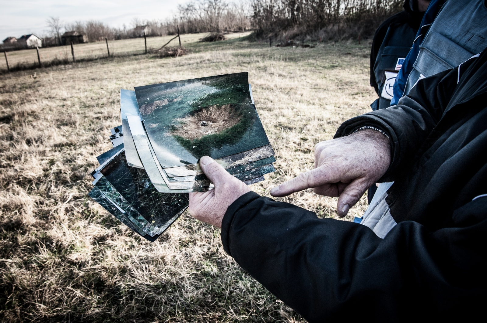 A famer shows some photographs of NATO bombing in 1999. All his crops of tomatoes, peppers and corn were destroyed. December 2016.