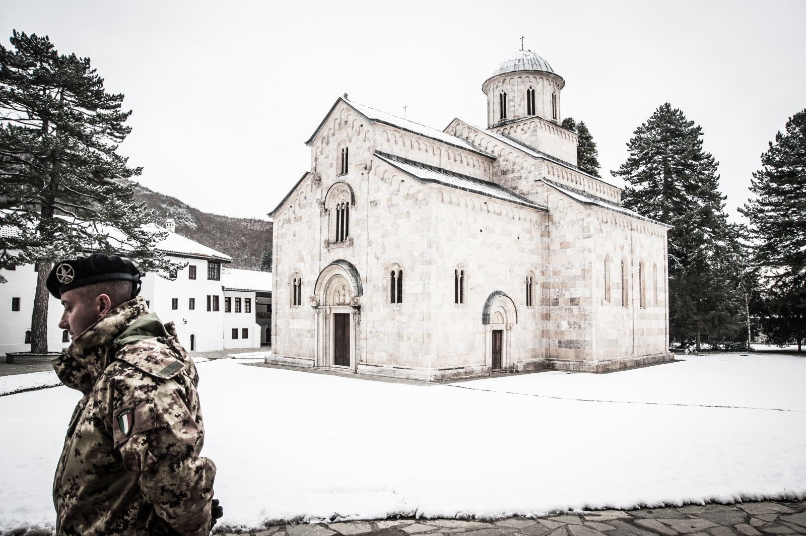 A KFOR soldier patrols the Serbian Orthodox monastery of Visoki Dečani. Since 1999, the Multinational Battle Group West is responsible for the daily supervision of the site which plays an important symbolic-religious role in an Albanian majority territory.
