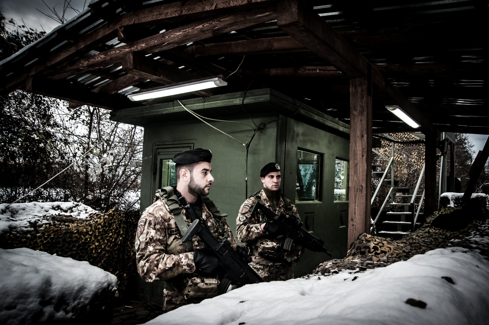 Two KFOR soldiers during the monitoring service at one of the checkpoints surrounding the monastery of Visoki Dečani. The service has an average duration of six hours, with six others in case of an intervention required. They have to patrol the area keeping the focus on the monastery's outdoor boundaries.