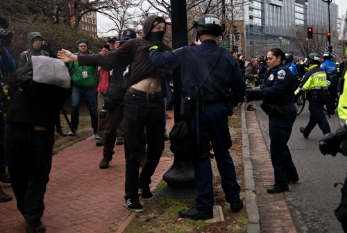 January 20, 2017 - Washington, DC, United States: An anti-trumpprotestors is hel dby the Washington DC Police Department Officer during an ongoing protest on the day President Trump was inaugurated.