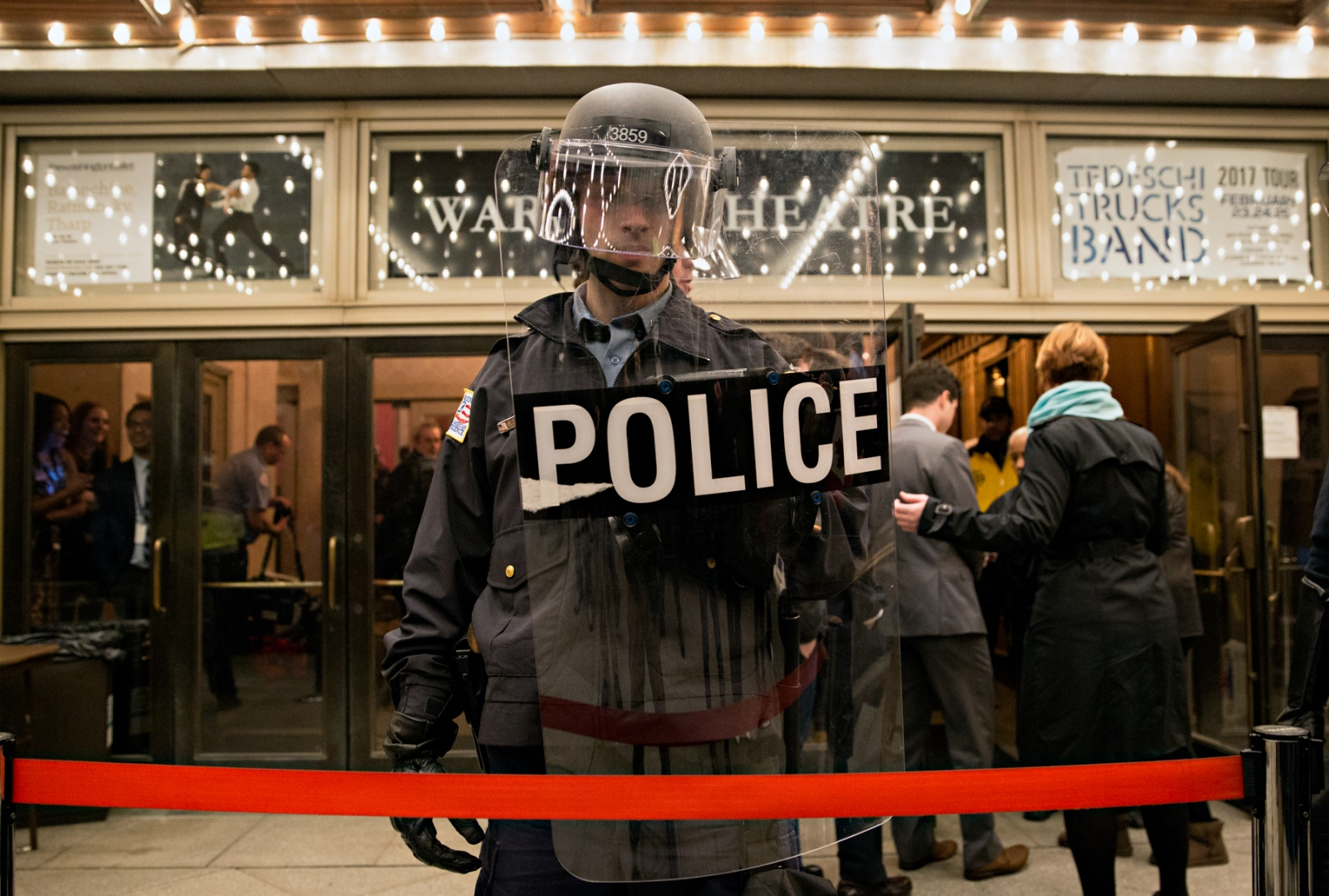 January 19, 2017 - Washington, DC, United States: A Washington, DC police officer in riot gear protects the entrance of an inauguration night event to prevent protestors from entering the event. There were many such events where high profile celebrities attended and mingled with each other. In this particular one, protestors were waiting the arrival of Sean Hannity and were prepared to throw eggs at him if they saw him and had the opportunity.