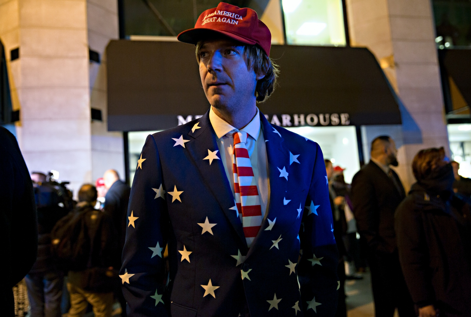 January 19, 2017 - Washington, DC, United States: A supporter of Donald Trump risks his safety and negotiates his way past protestors to a party held in honor of the new President. At times, Donald Trump supporters would cause a steer among the protestors and walk among them waiving flags and various paraphernalia with Trump's picture on them, and at times, the protestors would assault and beat those who would cause such a provocation.