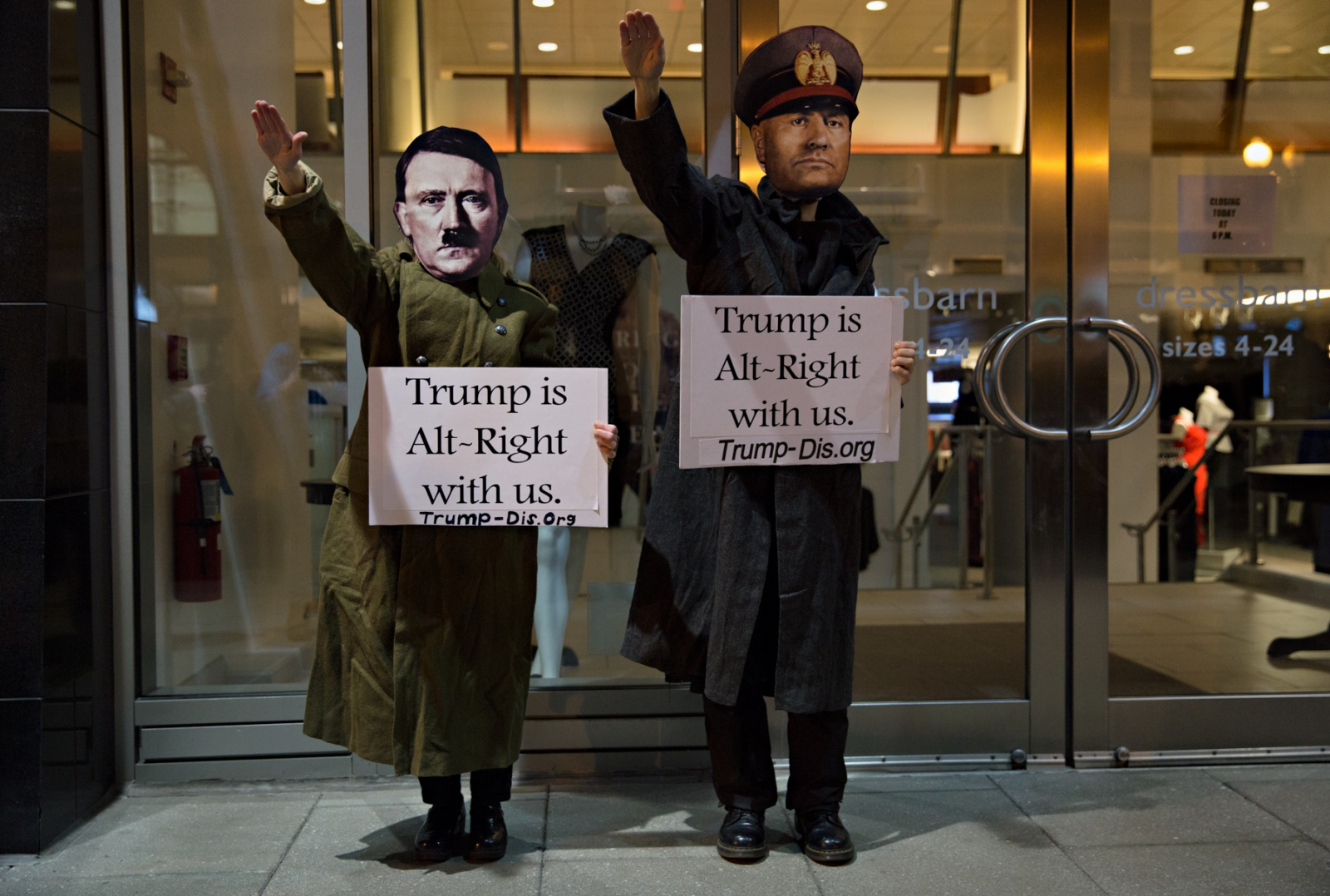 January 19, 2017 - Washington, DC, United States: Two protesters raise their right hand in a Nazi Salut to show their opinion of the Donald Trump and his supporters during a protest the night before the inauguration.