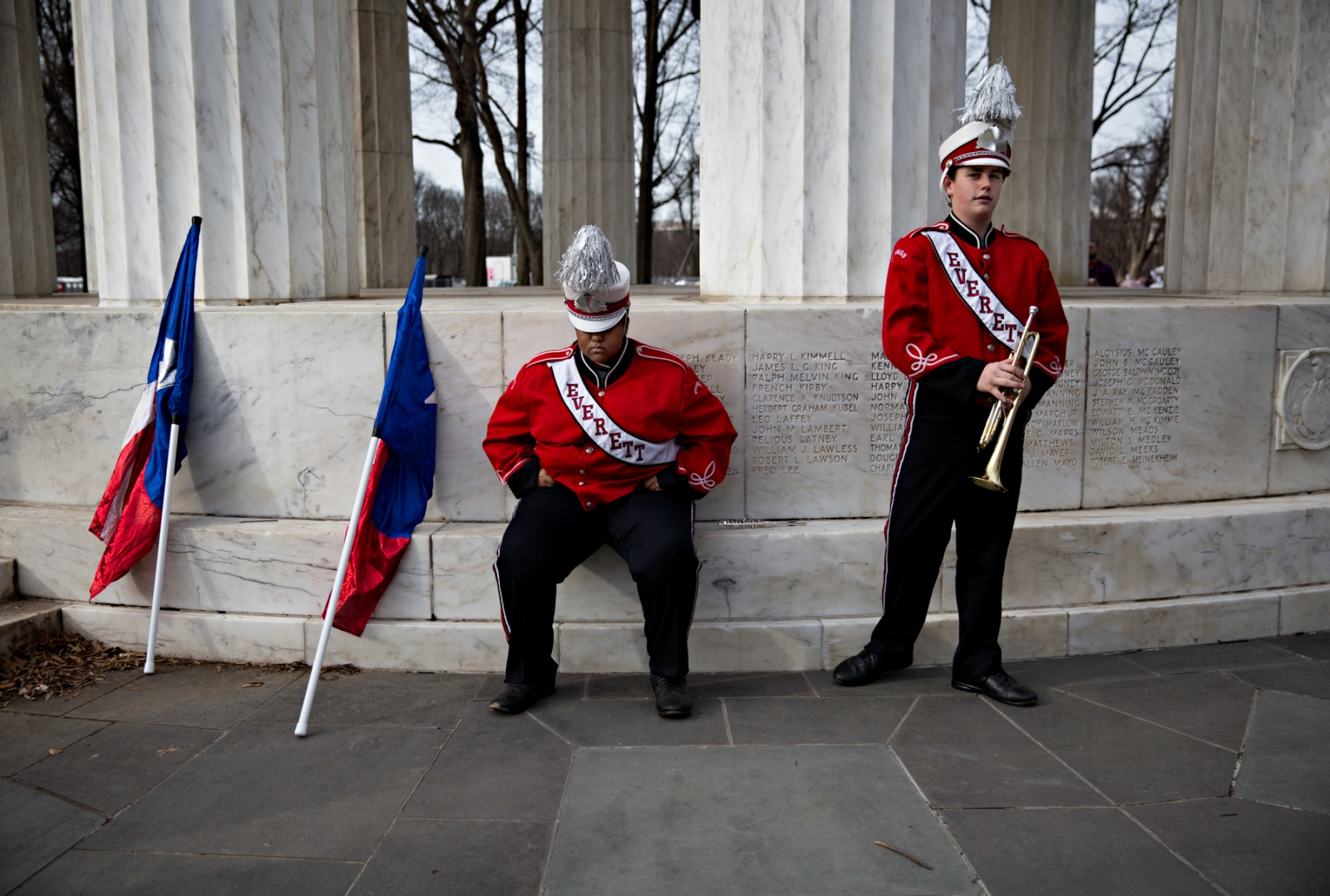 January 19, 2017 - Washington, DC, United States: Members of the Everett High School Band relax after having played in honor of the President Elect Donald Trump at the Lincoln Memorial. The day before Donald Trump's inauguration ceremony, Washington DC was filled with various ceremonies with marching bands from many different parts of the United States paying tribute to the newly elected President.