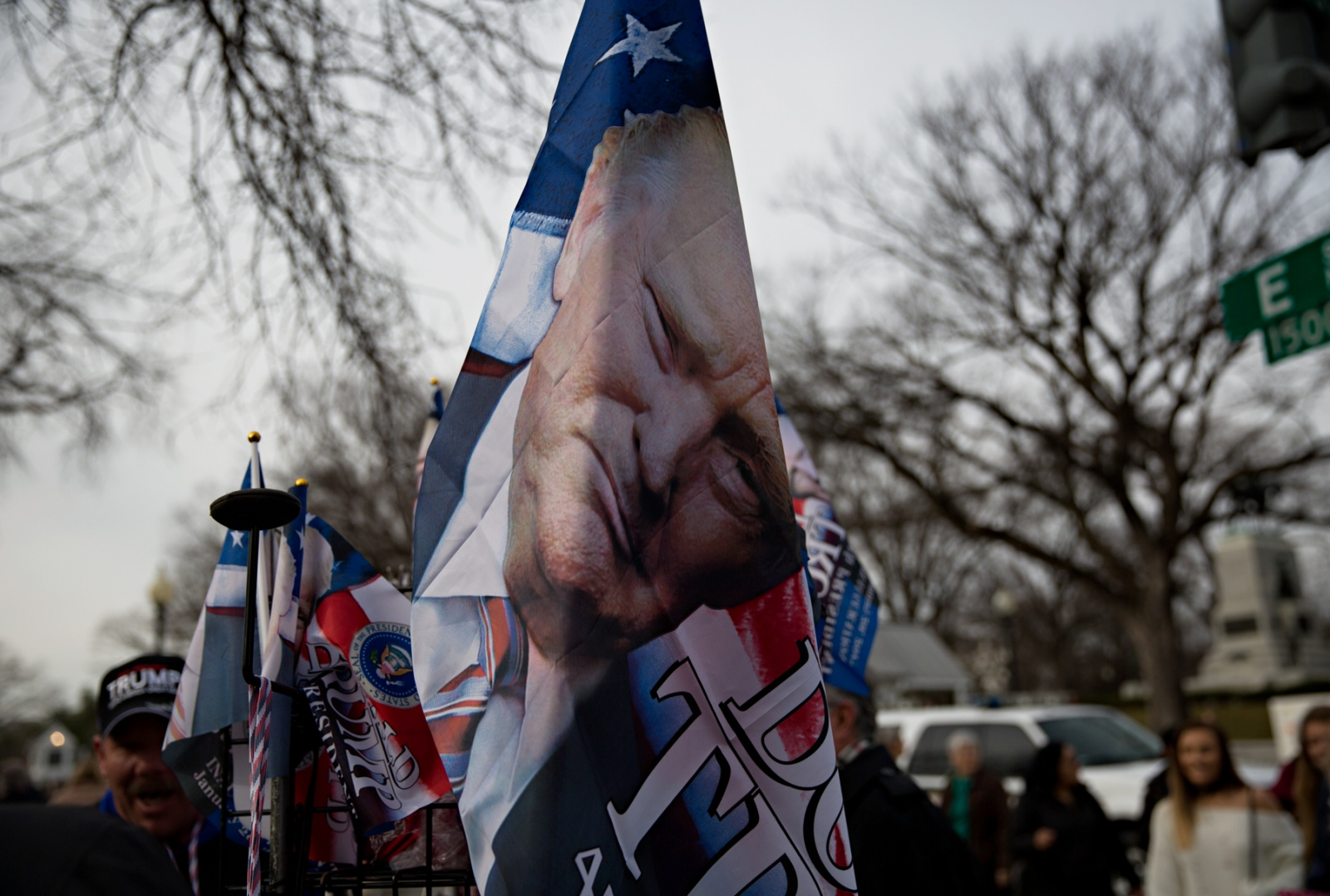 January 19, 2017 - Washington, DC, United States: Donald Trump flags for sale during the Inauguration weekend. On the day of inauguration of the 45th President of the United States, the picture of Donald Trump could be found on pretty much anything upon which a picture could be printed. Here, the ominous image of the President on a flag.