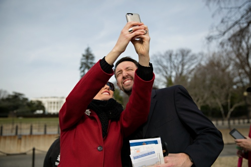 January 19, 2017 - Washington, DC, United States: A couple take a selfie in front of the Whitehouse.