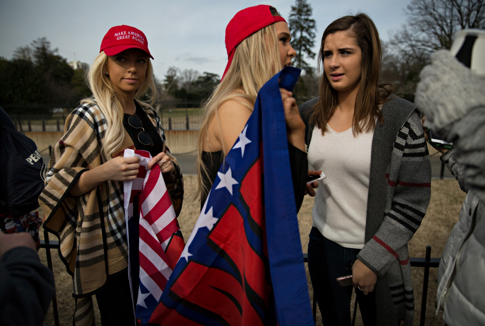 January 19, 2017 - Washington, DC, United States: Three Young women show their support for Donald Trump in front of the Whitehouse. Wearing the colors of your party is a must on the inauguration day--this mantra of course includes Burberry.