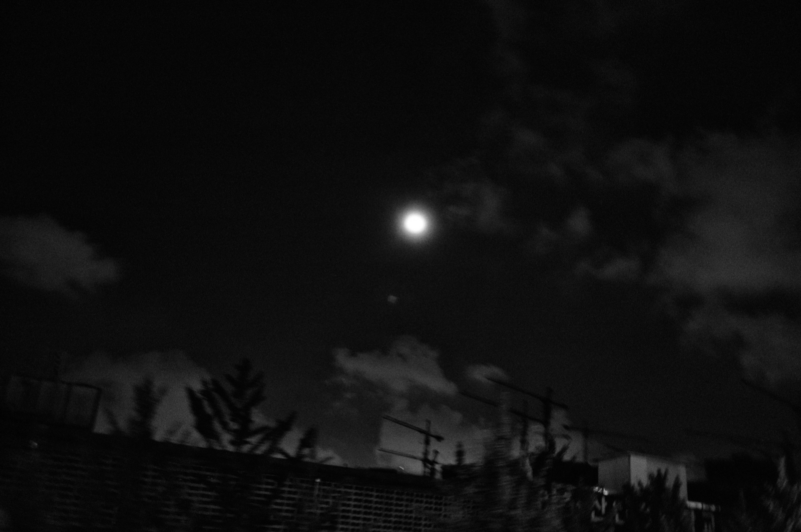 The moon over a construction site in Mapo, Aug. 15, 2013, Seoul, South Korea.