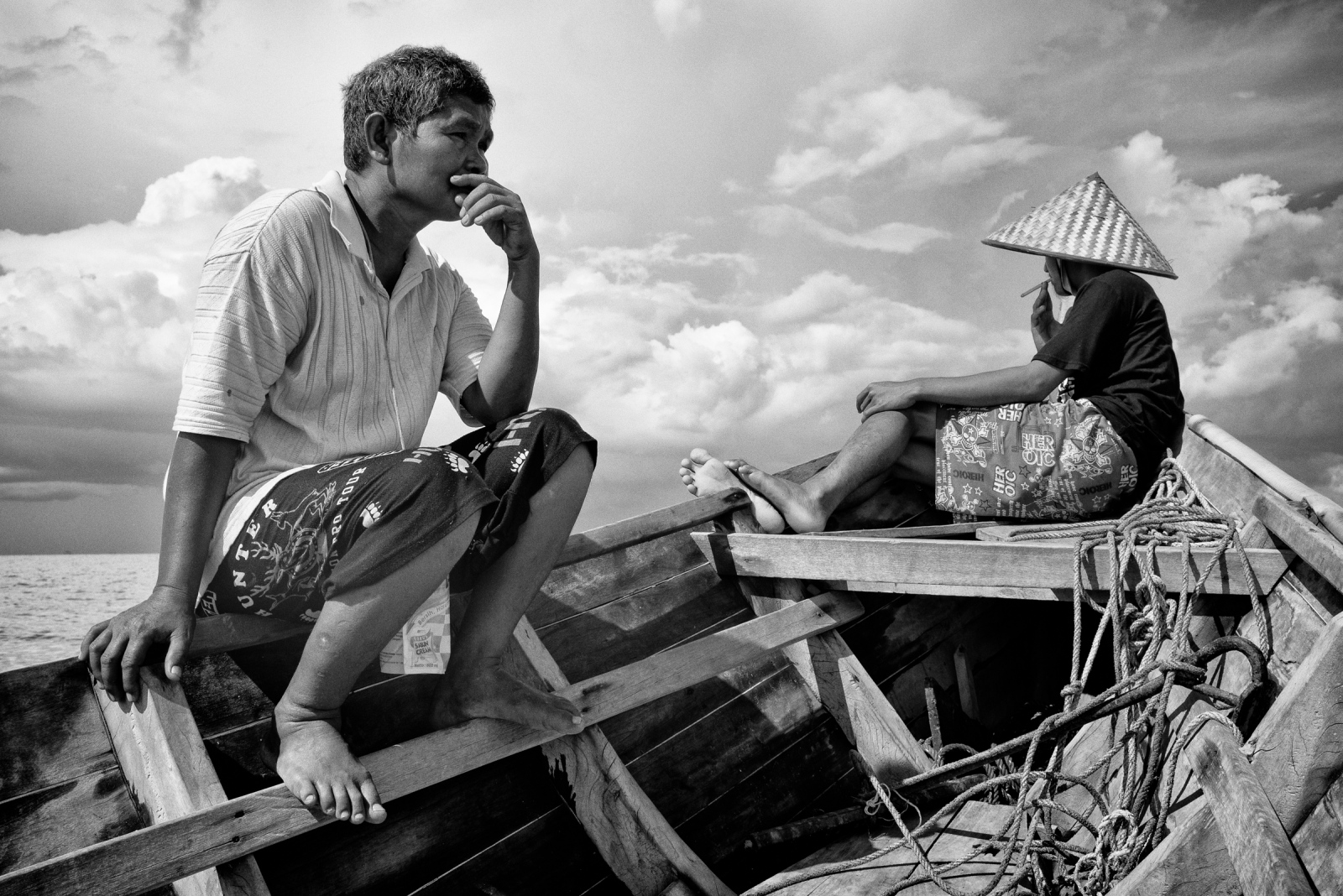 Roaidi and his son Kuruniawan take rest on his fishing boat at West Bangka sea, Indonesia onMay 7, 2016. Roaidi, a 50 years old fisherman who is a native to the area claims that the ocean is seriously damaged by offshore tin mining. He used to get 25~35kg of fishes per day in 1 miles from the shore, but he has to sail to 25 miles from the shore to get that amount.