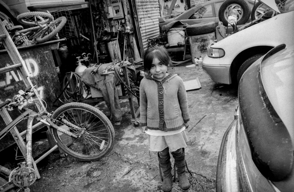 Lina's daughter in front of her mother's shop.