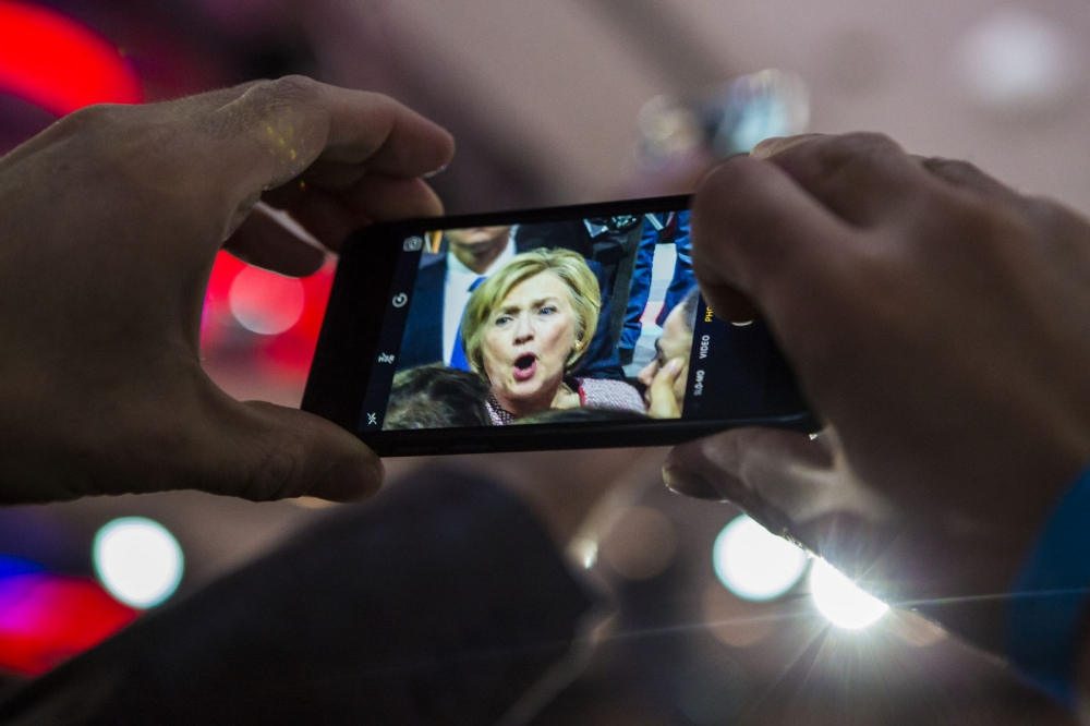 Supporter of Democratic Presidential candidate Hillary Rodham Clinton takes a cellphone photo of her at her victory celebration at the Sheraton in New York City, where she claimed victory tonight, over rival Presidential candidate Bernie Sanders with 60% of the voters over BernieԳ 40% registered voters in the New York Primaries. April 19, 2016 (Kevin C. Downs/Cosmos)