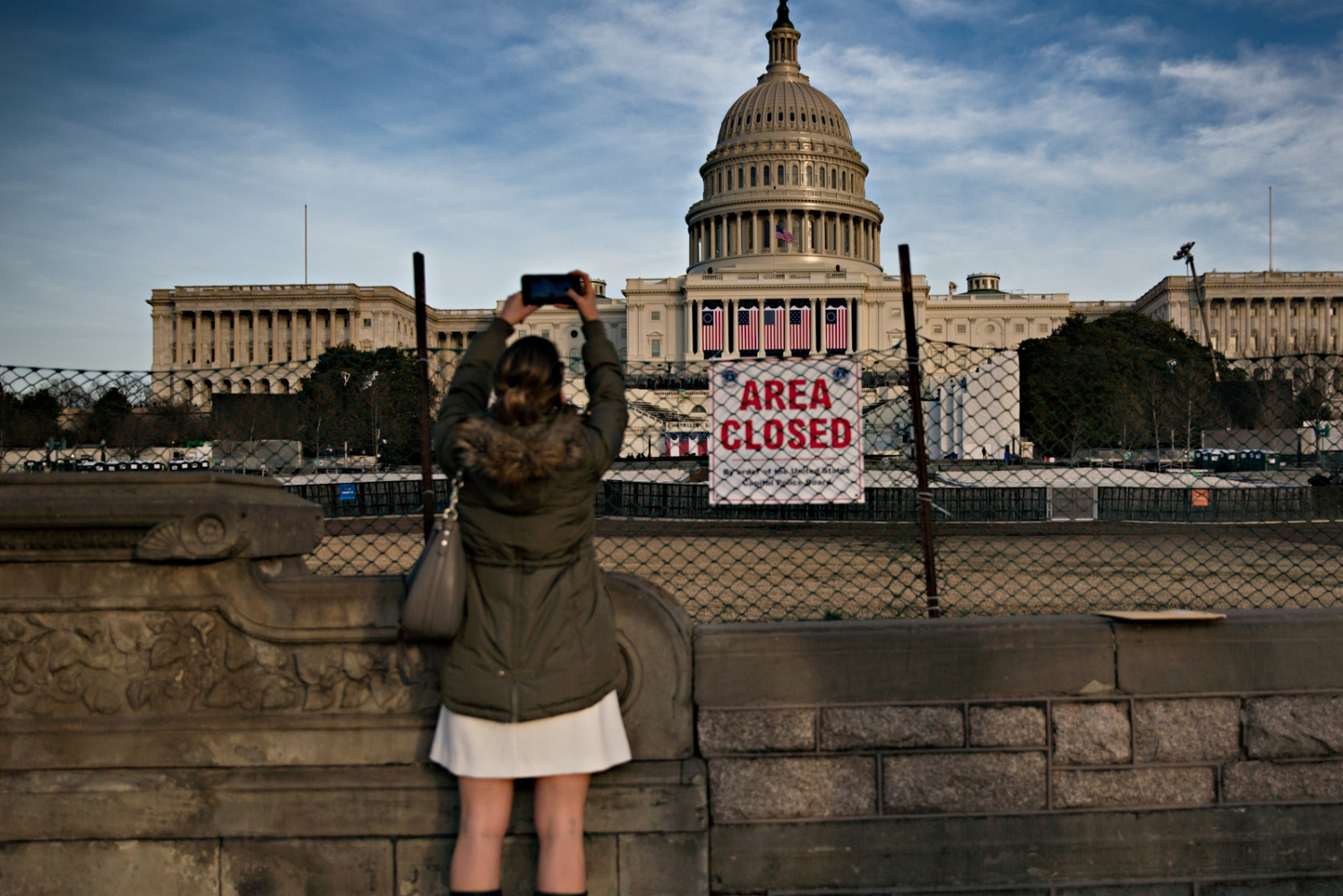January 19, 2017 - Washington, DC, United States: A visitor takes picture of the Capitol Building which was closed to public during the rehersal for the Inauguration.