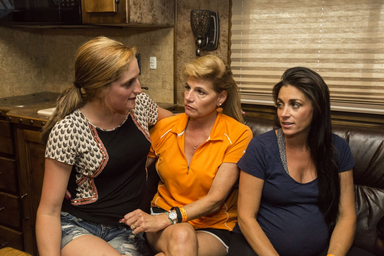Taylor Young with her mother Anna Shields-Young and Jayme Myers, her sister, and trainer, inside of their caravan, discussing her ride tonight at the Malibu Rodeo in Milford, Pennsylvania. This is the first time her mother will be seeing Taylor compete in a rodeo. (Kevin C. Downs/Agence Cosmos)