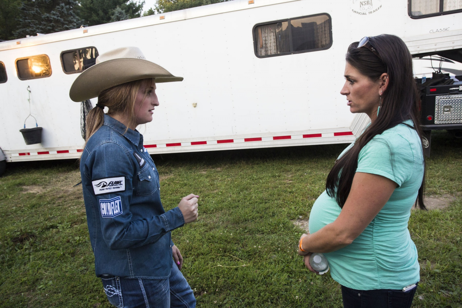 Taylor Young talking to Jayme Myers, her sister, and trainer, about barrel-racing techniques at Malibu Rodeo in Milford, Pennsylvania.  (Kevin C. Downs/Agence Cosmos)
