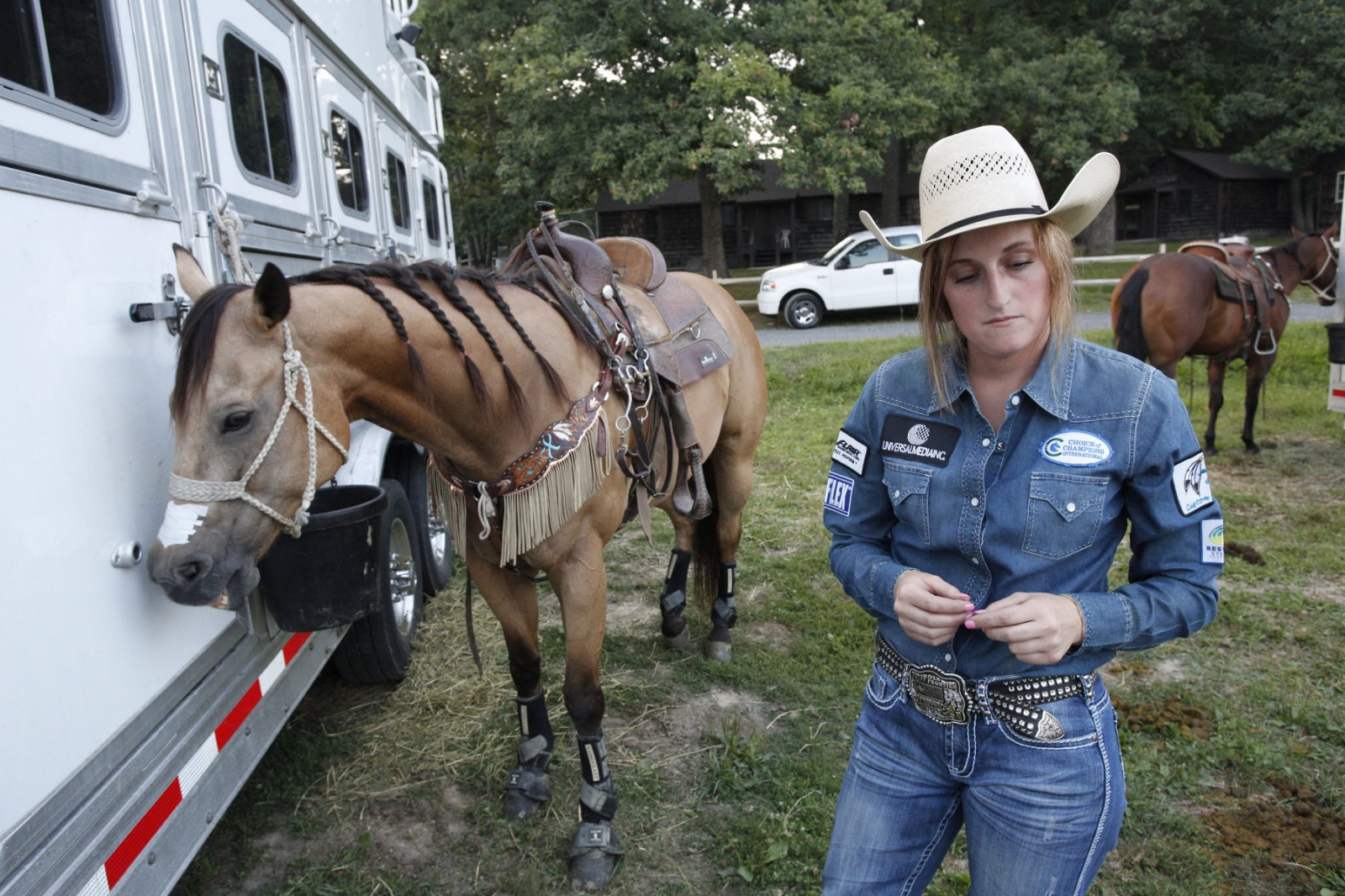 Taylor Young listening to the announcer about a young male bull rider who was severely injured at Malibu Rodeo in Milford, Pennsylvania.(Kevin C. Downs/Agence Cosmos)