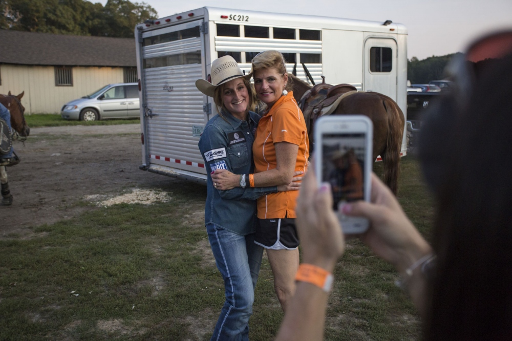 Taylor Young and her mother Ann Shields-Young, pose for a photo taken by an iPhone by Jayme Myers, her sister, and trainer, at Malibu Rodeo in Milford, Pennsylvania. Kevin C. Downs for Cosmos