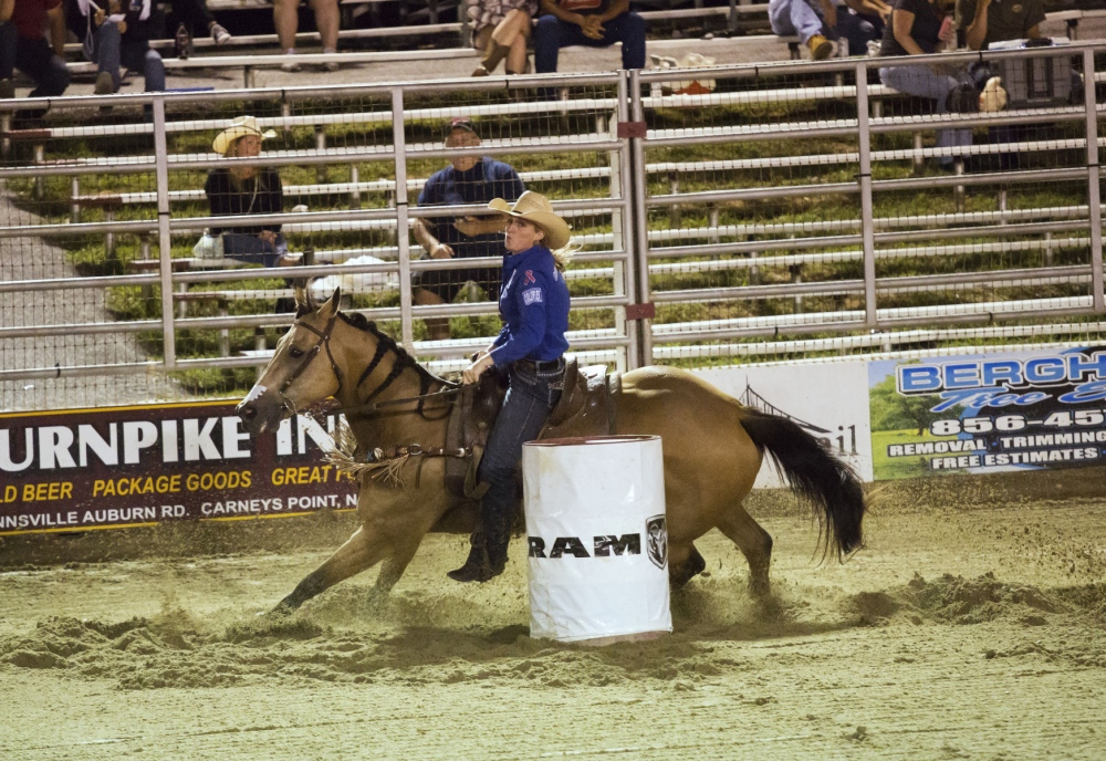 Taylor Young and Tsunami competing in barrel racing at the Cowtown, New Jersey.  (Kevin C. Downs/Agence Cosmos)