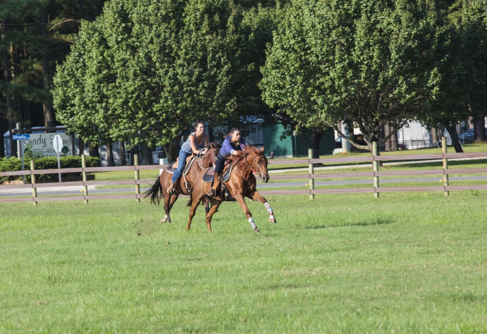 Devin Redding, with Chelsea Bowman, racing their horses before Devin leaves for South Carolina. August 22, 2015 (Kevin C. Downs/Agence Cosmos)