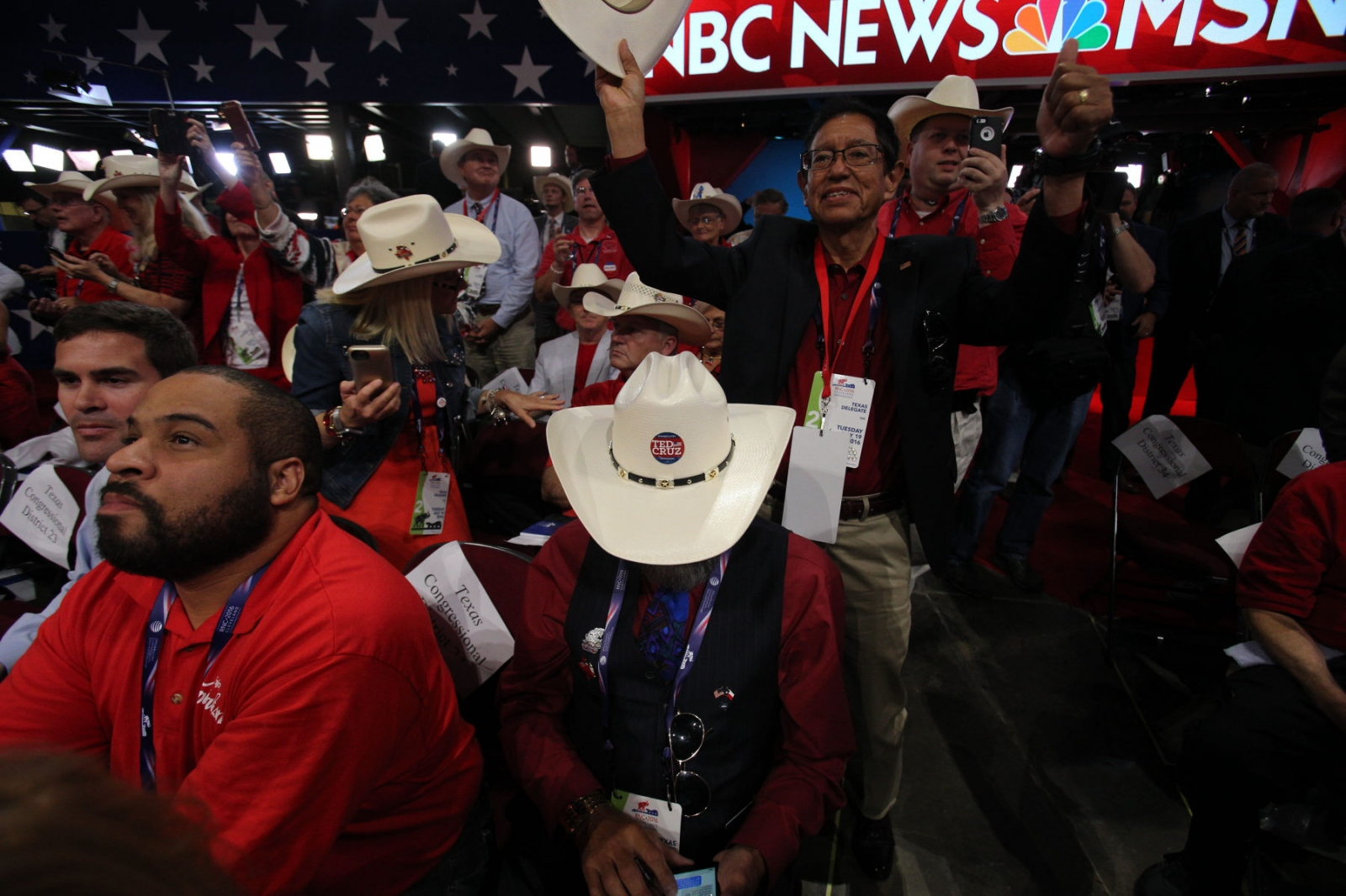 A Texas delegate who is one of the last Cruz supporters in the Texas delegation, surrounded by Trump supporters, at theRepublican National Convention. July 20, 2016 (Kevin C Downs).