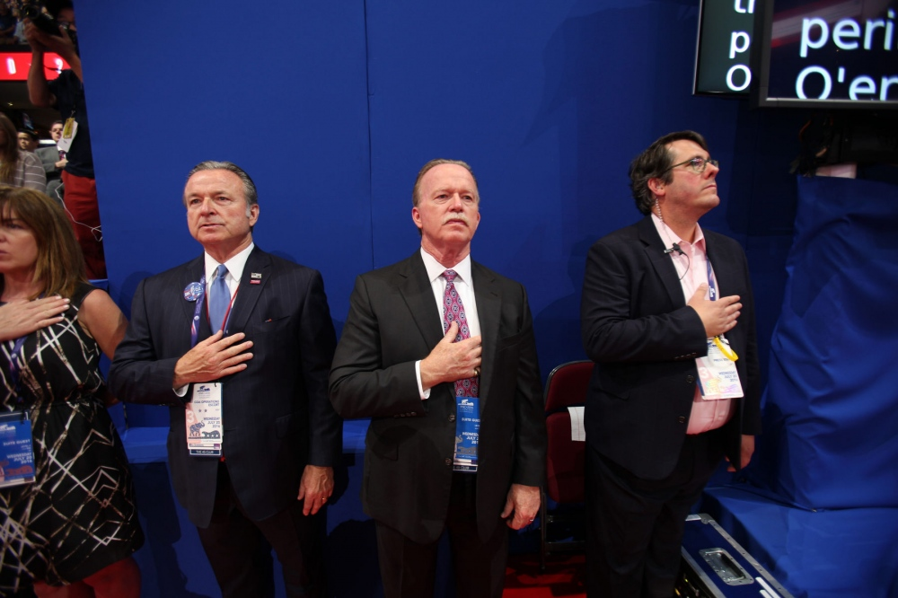 Delegates at the Republican National Convention in Cleveland Ohio stand at attention to the pledge of allegiance. July 21, 2016 (Kevin C Downs).