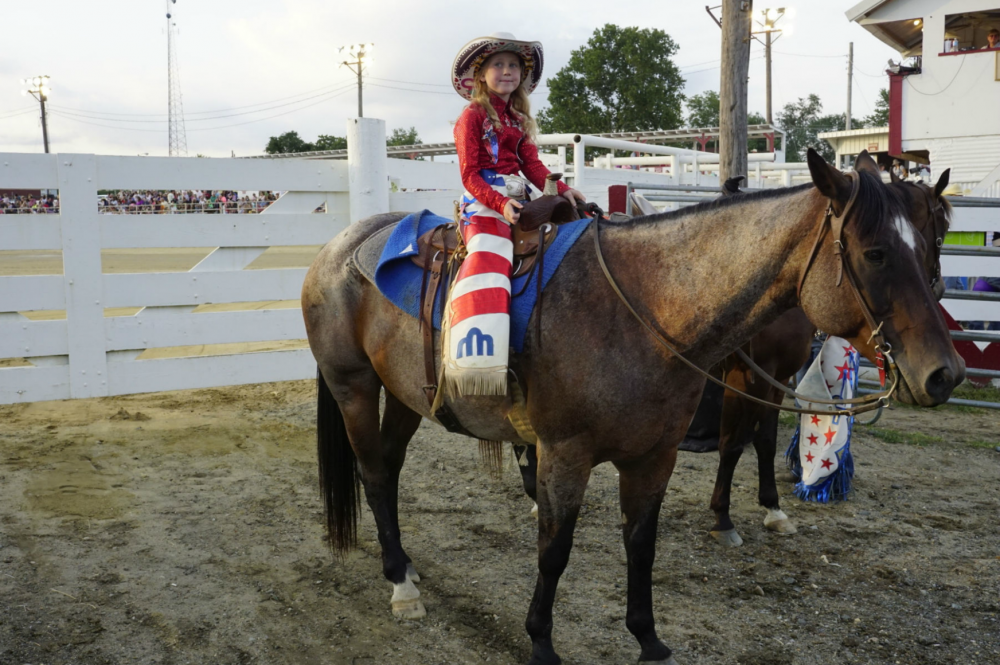 Taylor Young, (R) a young 22-year old Professional Rodeo Athlete, with friends at Cowtown Rodeo, before she rides in the event that she eventually lost that evening.