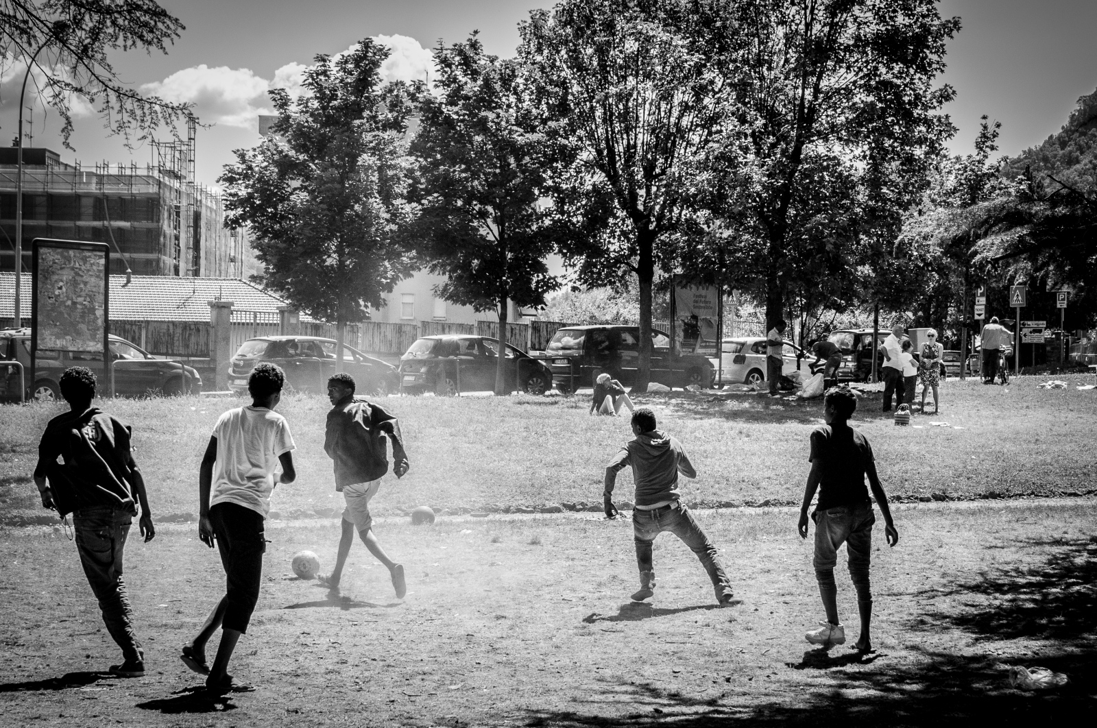 A football match between migrants provides momentary respite in the face of numerous hardships.