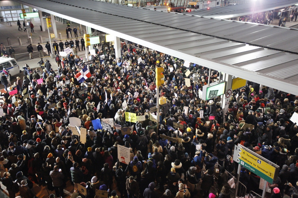 Thousands of protesters block the street at the arrivals area at terminal 4 at JFK to protest Trump's Muslim ban and to show support for people still being held inside the airport and not being allowed to leave to visit or go home to their relatives and friends. John F. Kennedy Airport, Queens. January 28, 2017 (Kevin C. Downs)