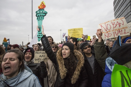 Thousands of protesters block the street at the arrivals area at terminal 4 at JFK to protest Trump's Muslim ban and to show support for people still being held inside the airport and not being allowed to leave to visit or go home to their relatives and friends. John F. Kennedy Airport, Queens. January 28, 2017 (Kevin C. Downs/Agence Cosmos For New York Daily News)
