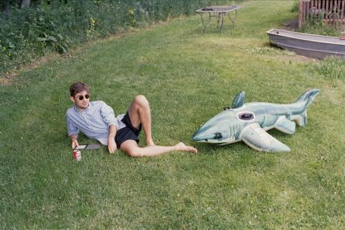 Denis reading by the pond, Roscoe, NY