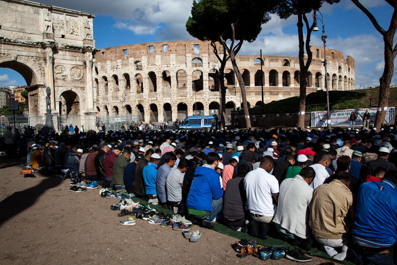 Hundreds of members of the Muslim community of Rome are gathered for the Friday communal prayer in front of the Colosseum, to protest against the closure of a few mosque in the southeastern part of the city.