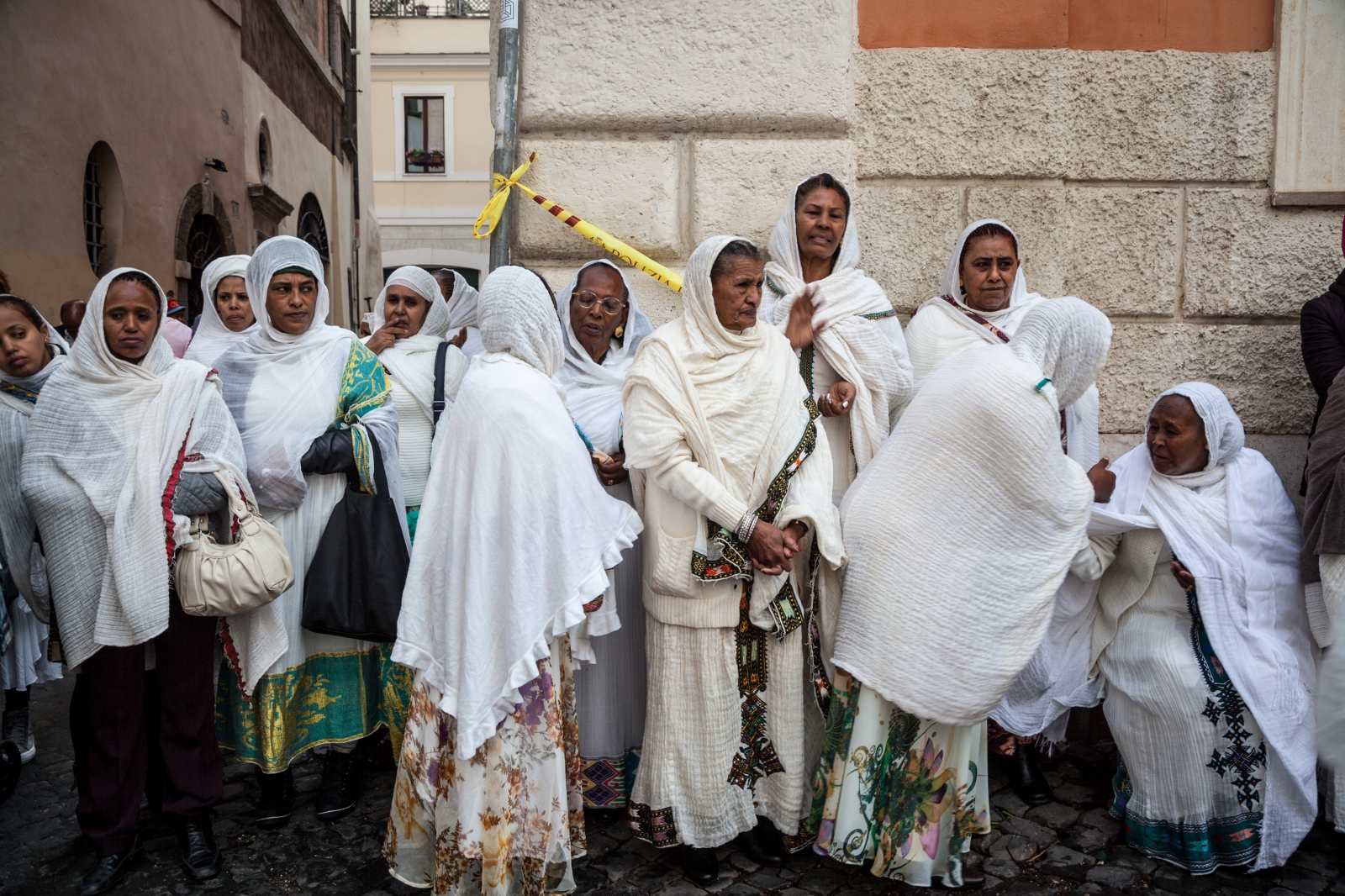 Eritrean and Ethiopian women talk outside the Eritrean Orthodox Tewahedo Church St. Michael's in downtown Rome, right around the corner from Campo de' Fiori, during the celebration for the patron saint of the community.