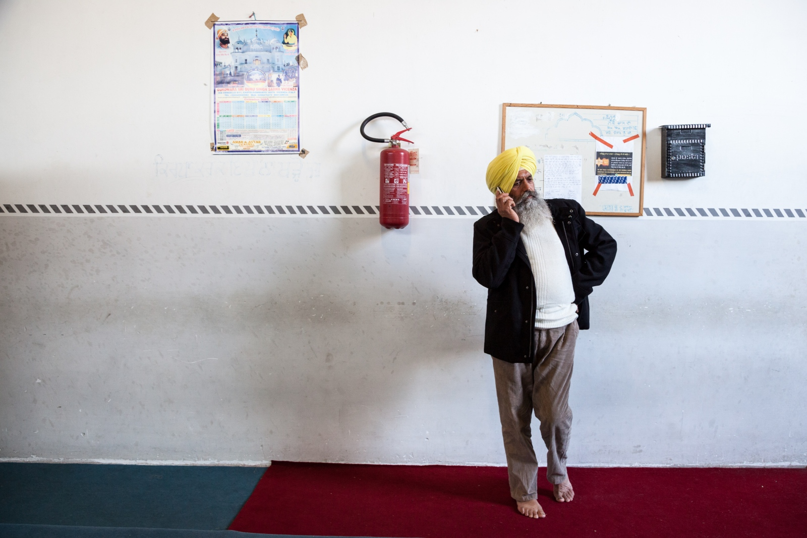 Inside a Sikh temple in the Massimina neighborhood of northern Rome, a man takes a break from the Sunday celebration.