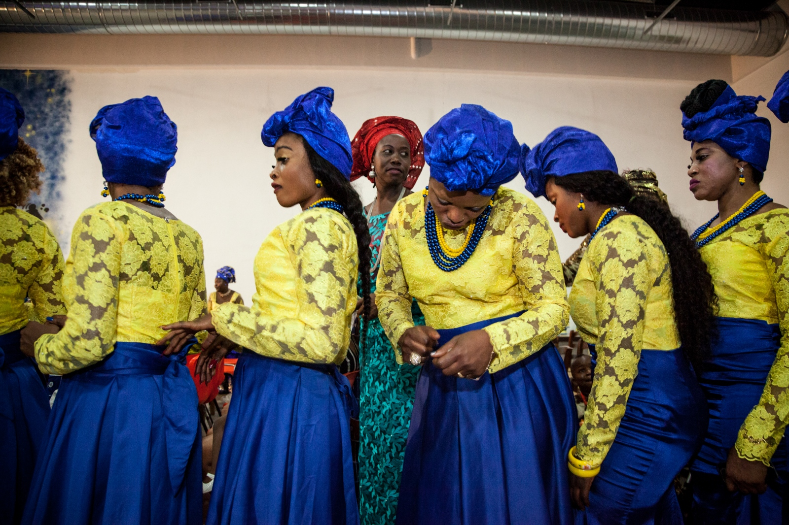 Testimony's bridesmaids walk to the dancefloor during the wedding reception. Testimony and Mike are a young couple from Nigeria, they live in Rome and they are members of the Apostolic Church, God's Mercy Family, in Torre Angela, a working class neighborhood in the far eastern suburbs of the city.
