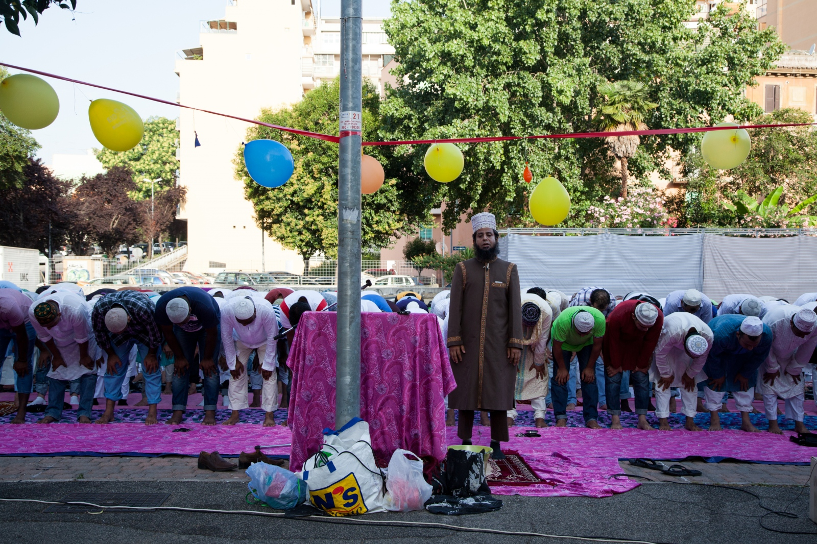 Members of the Bangladeshi community of Rome perform the Eid al-Fitr prayer, that marks the end of Ramadan, in a public square in Torpignattara, a working class neighborhood in the southeastern suburbs of Rome.