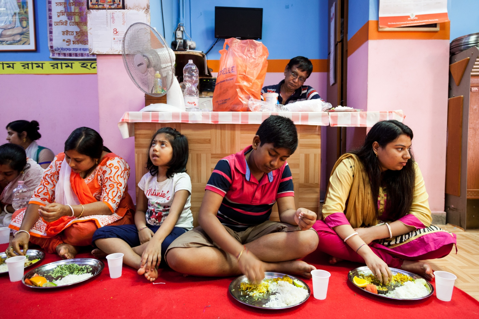 """On Krishna Janmashtami, the annual celebration for the birthday of the deity Krishna, some people eat their lunch in the """"Om Hindu Mandir"""" temple of Torpignattara, a working class neighborhood in the southeastern suburbs of Rome."""