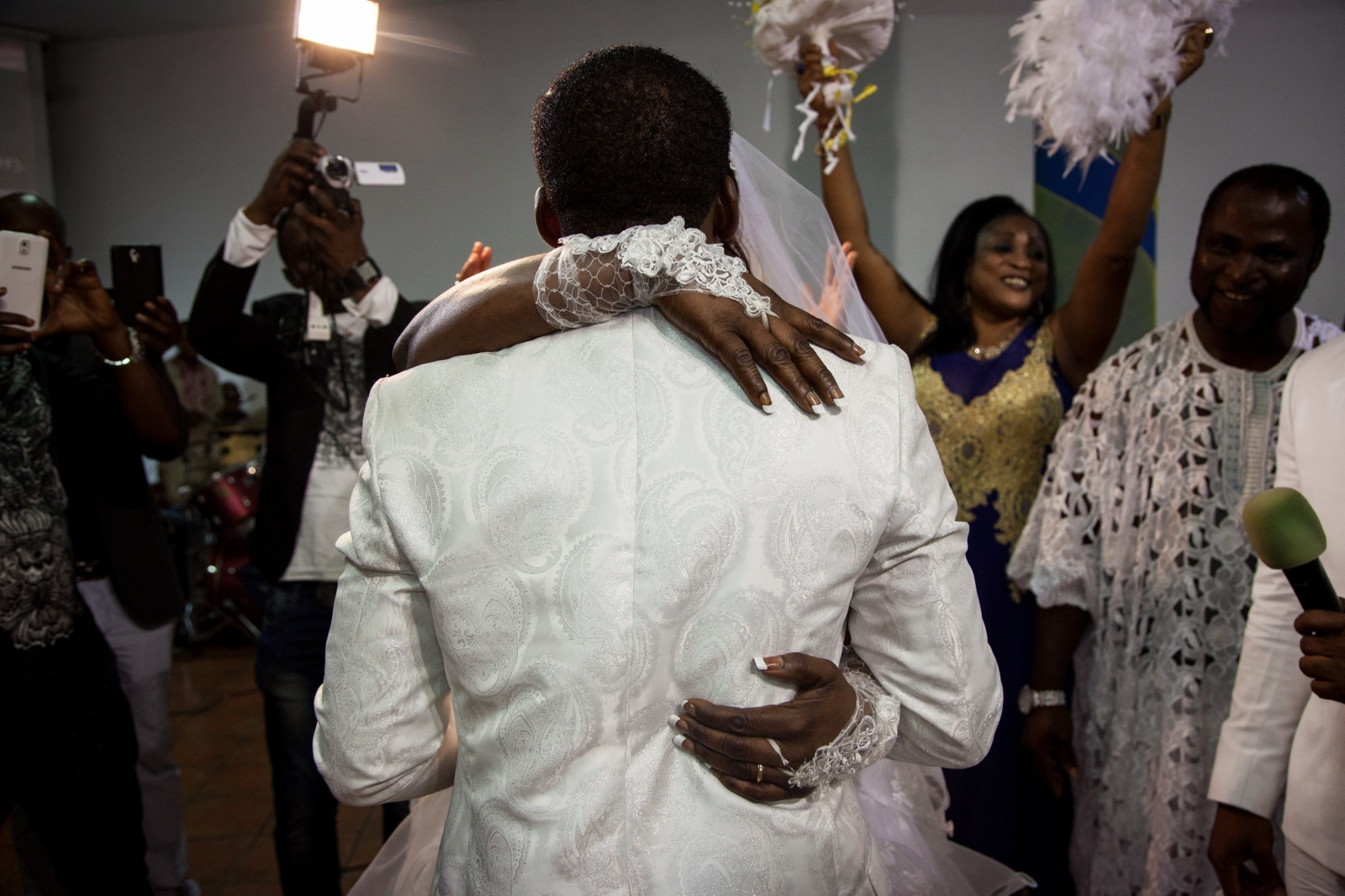 Testimony and Mike, from Nigeria, exchange their first kiss as a married couple in front of their friends and family in the Nigerian Apostolic Church, God's Mercy family in Torre Angela, a working class neighborhood in the far eastern suburbs of Rome.