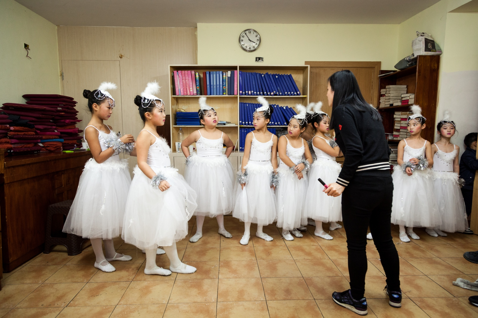 Little girls listen to the teacher's instructions while waiting to perform during the Christmas show at the Chinese Evangelical Church n the multicultural Esquilino neighborhood in downtown Rome.