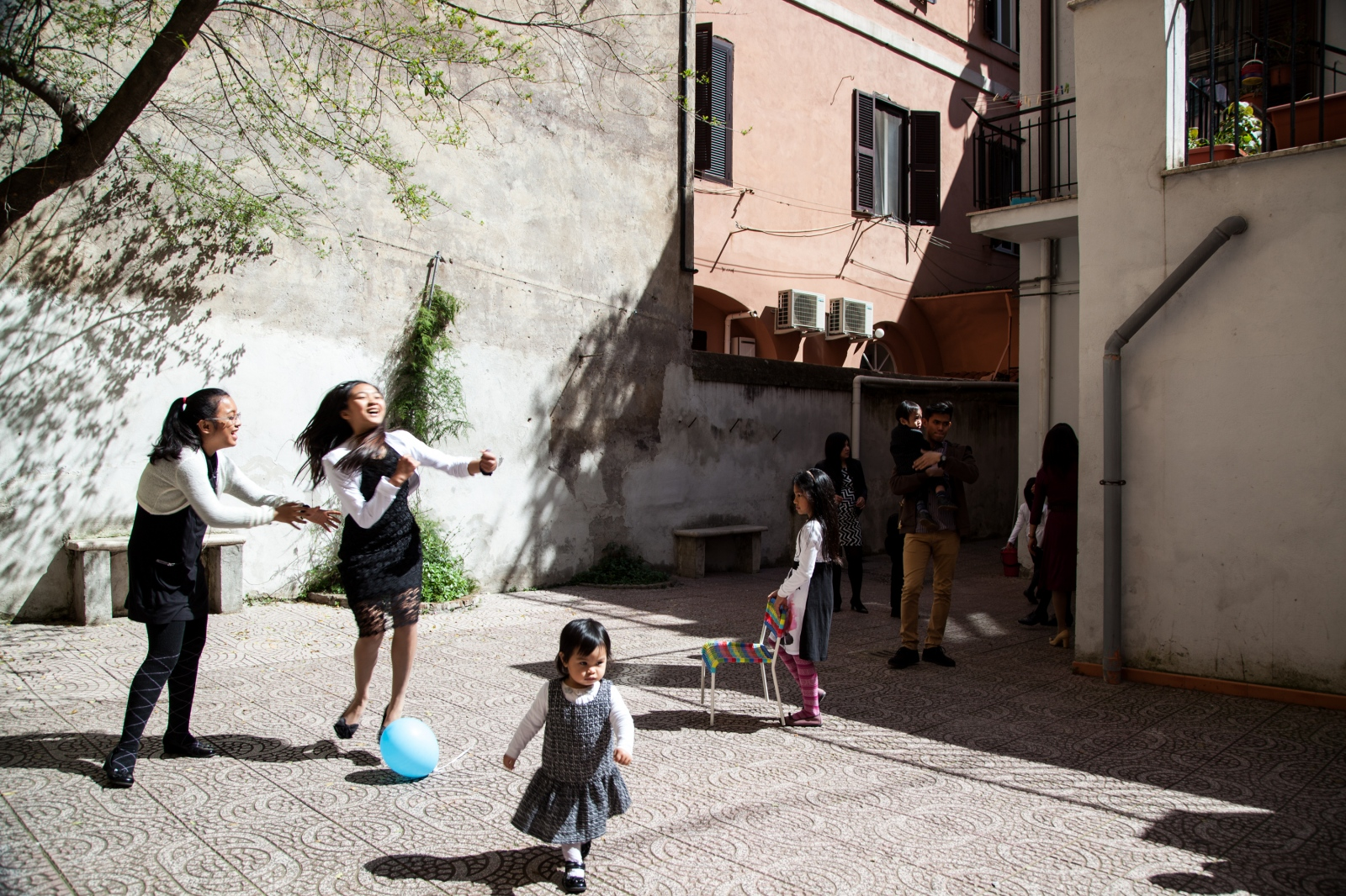 Kids play in the back of the Filipino Adventist Church, in Rione Monti, downtown Rome.