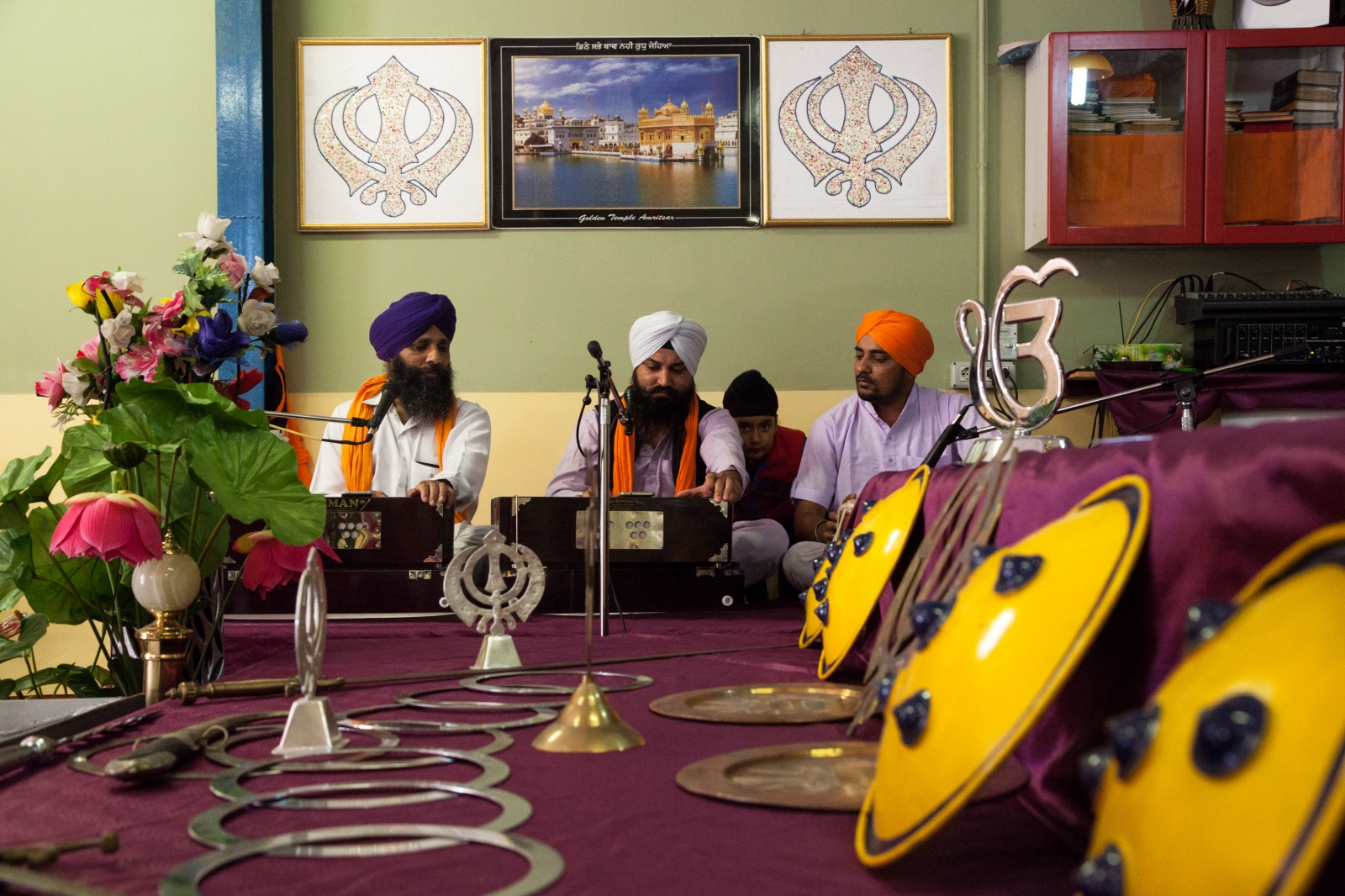 Sacred chants during the Sunday celebration in a Sikh temple just outside the ring road in the southeastern part of Rome.
