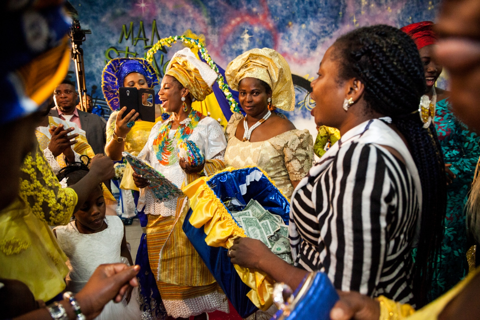 Testimony, a young bride from Nigeria, dances with her friends and relatives, during her wedding day. Testimony and Mike, both from Nigeria are members of the Apostolic Church, God's Mercy Family, in Torre Angela, a working class neighborhood in the far eastern suburbs of Rome.