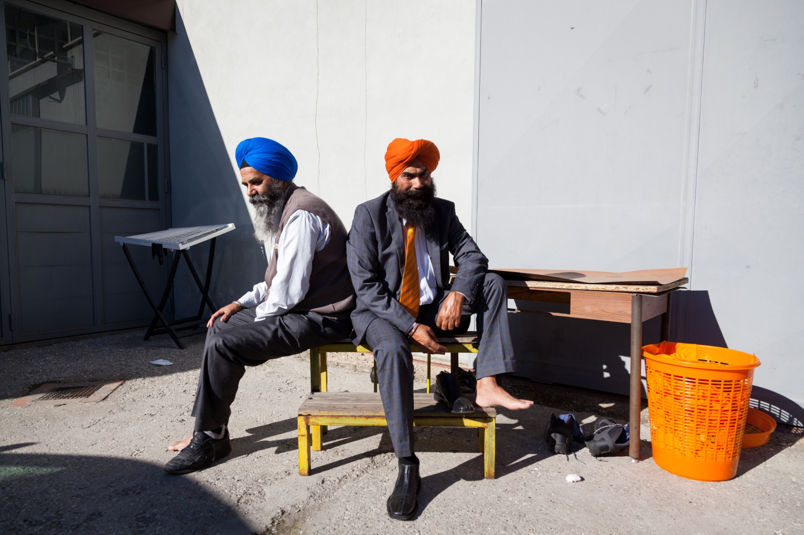 Two members of the Gurudwara Sri Gurunankdarbar, a Sikh temple just outside the ring road in the southeastern part of Rome, pose for a portrait after the Sunday celebration.